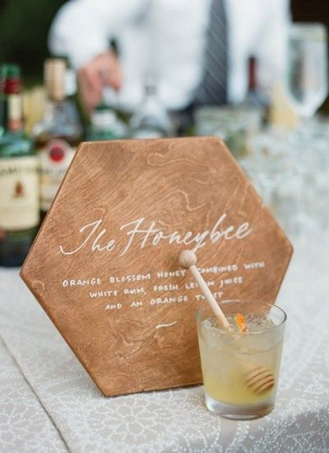 a honey signature cocktail with a honeycomb sign