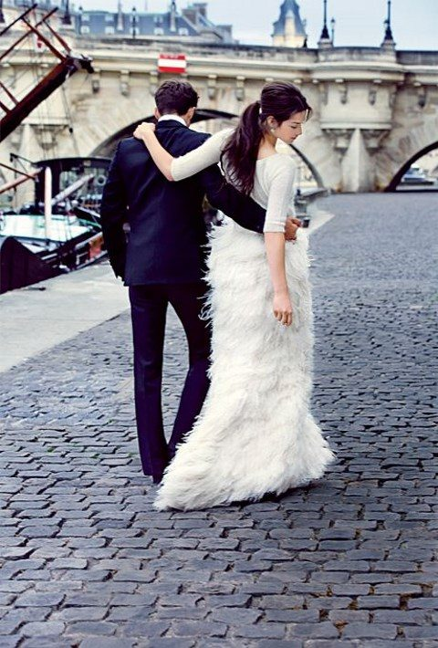a white sweater and a feather skirt is a great idea for cold weather