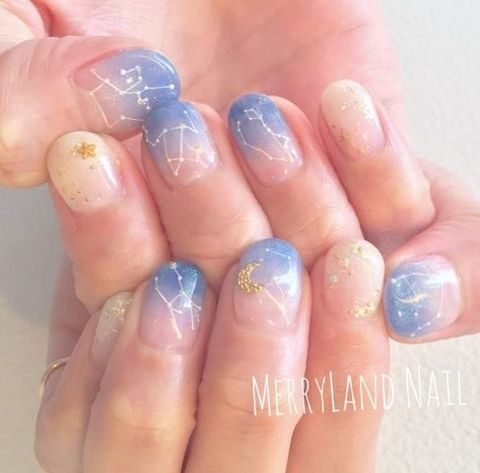 blue and neutral constellation nails with the moon and stars