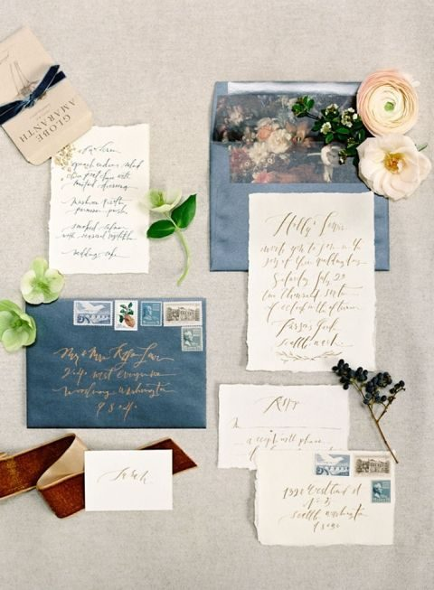 blue envelopes and watercolor lining with creamy invites