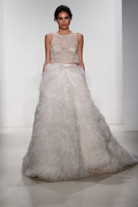 bridal separate with a sheer embellished top and a full feather skirt by Kelly Faaetanini