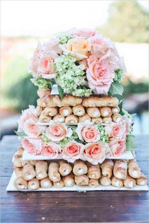 cannoli wedding tower served with fresh pink roses and hydrangeas