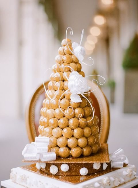 caramel topped croquembouche with sugar flowers and vignettes