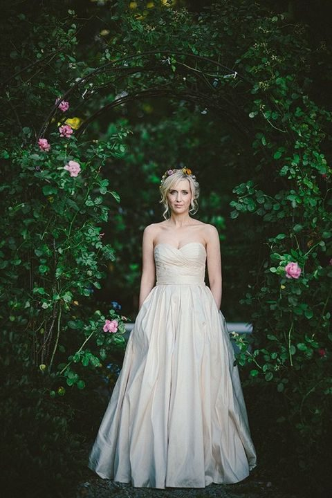 champagne-colored strapless draped wedding dress with pockets