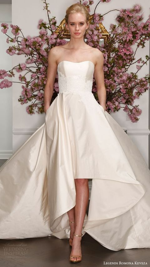 champagne-colored strapless high low train wedding dress with lace appliques and pockets by Romona Keveza