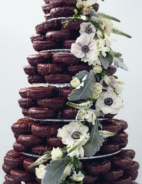 chocolate glazed donut wedding tower with fresh blooms