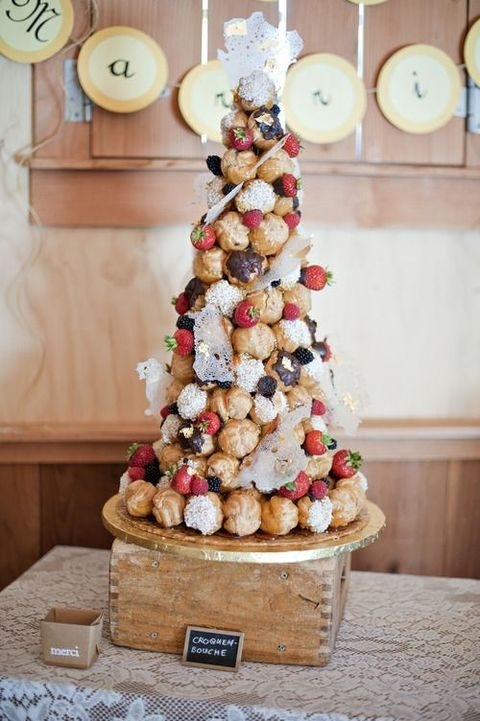 croquembouche with blackberries, strawberries and cream