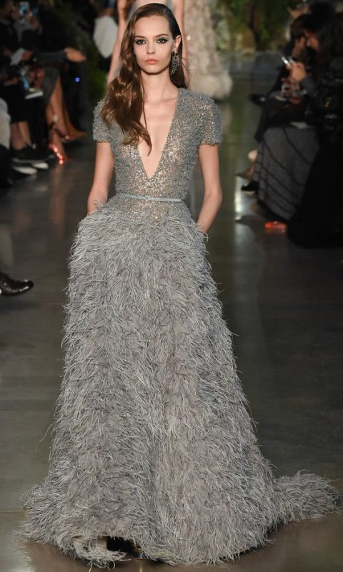 dark grey plunging neckline wedding dress with short sleeves and a feather skirt
