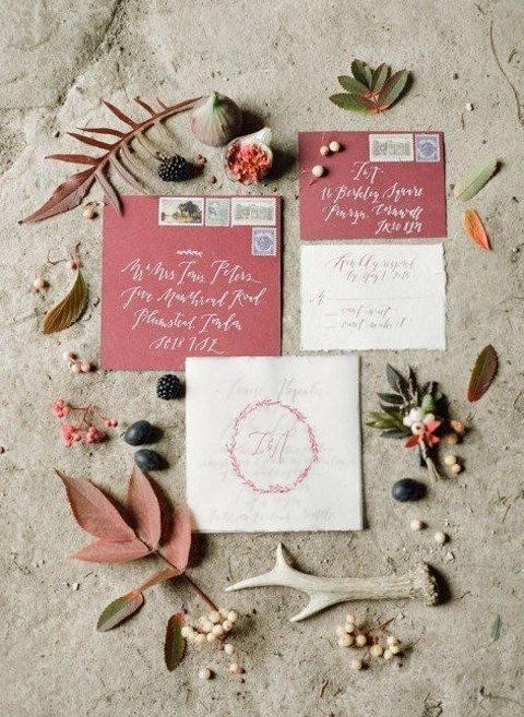 dark pink wedding invites with calligraphy and leaf decor