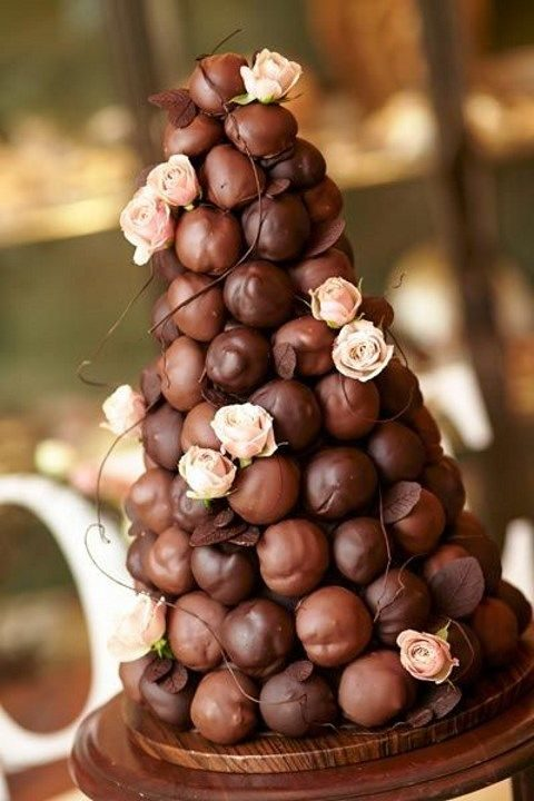 decadent chocolate croquembouche with fresh pink roses