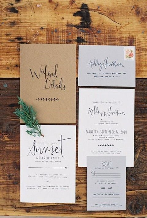 grey and calligraphy invites and a kraft paper envelope