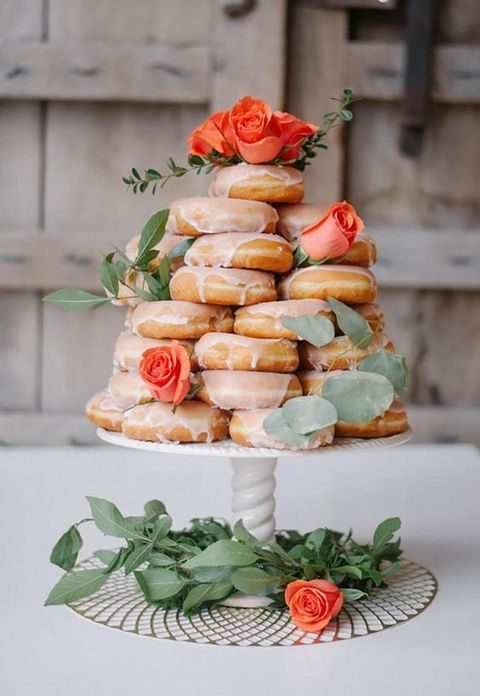 honey glazed donut wedding cake topped with coral roses
