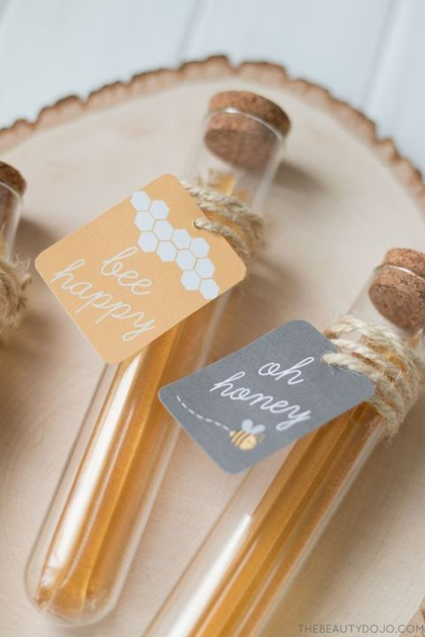 honey test tube favors wrapped with twine and with favor tags