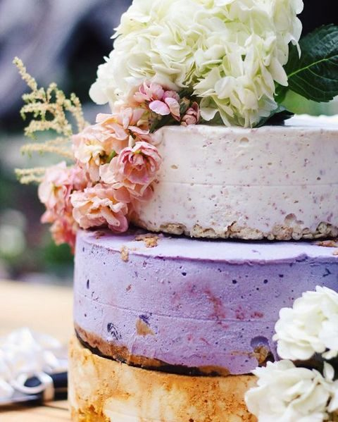 ice cream wedding cake of different tipes of ice cream and topped with flowers