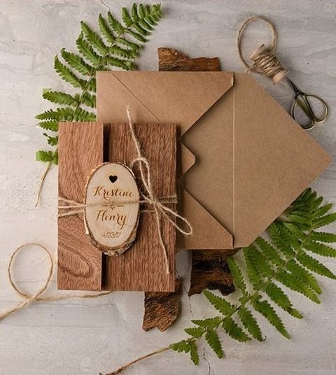 kraft paper and real wood wedding invites with twine and wood slice tags