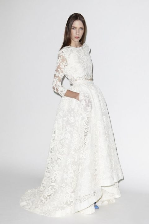 lace applique bridal separate with a long sleeve crop top and a high low skirt with pockets