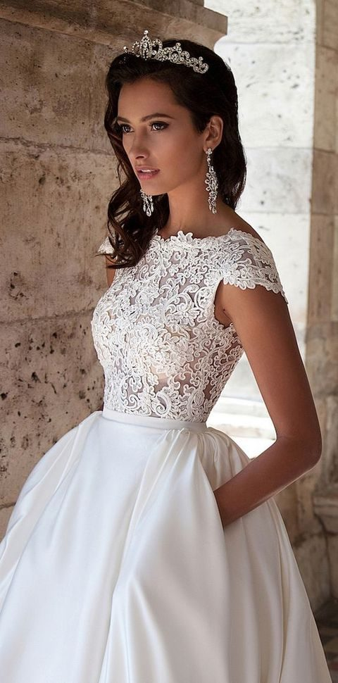 lace bodice, cap sleeves wedding dress with a plain skirt with pockets