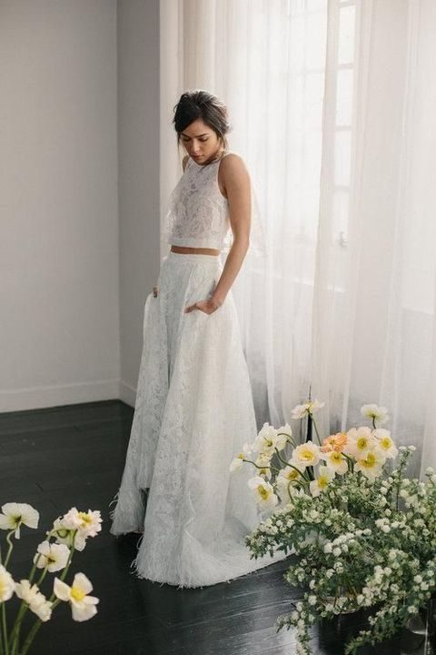 lace bridal separate with a halter neckline crop top and a high low skirt with pockets