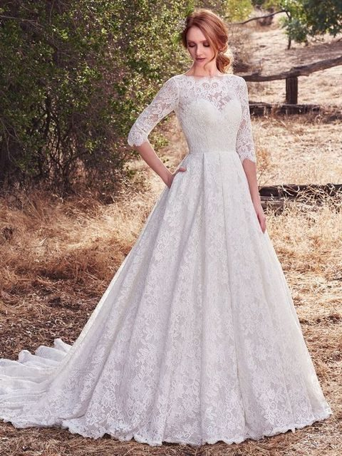 lace half sleeve illusion neckline wedding dress with pockets by Maggie Sottero