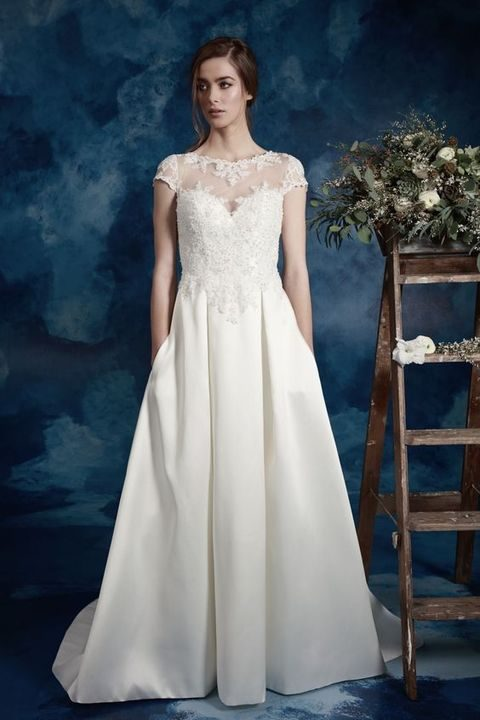 lace illusion neckline cap sleeve bodice with a skirt with pockets