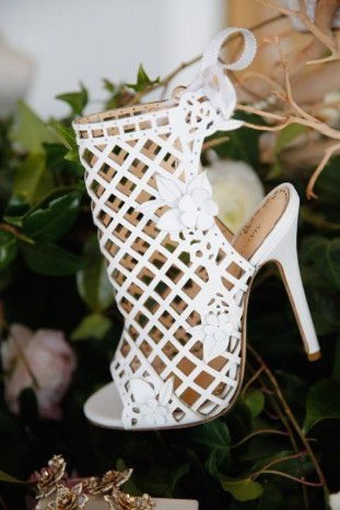 laser cut wedding shoes with flower decor and peep toes