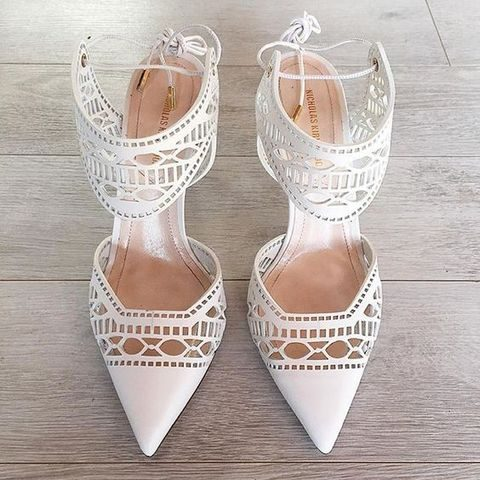 laser cut white wedding heels with thick ankle straps