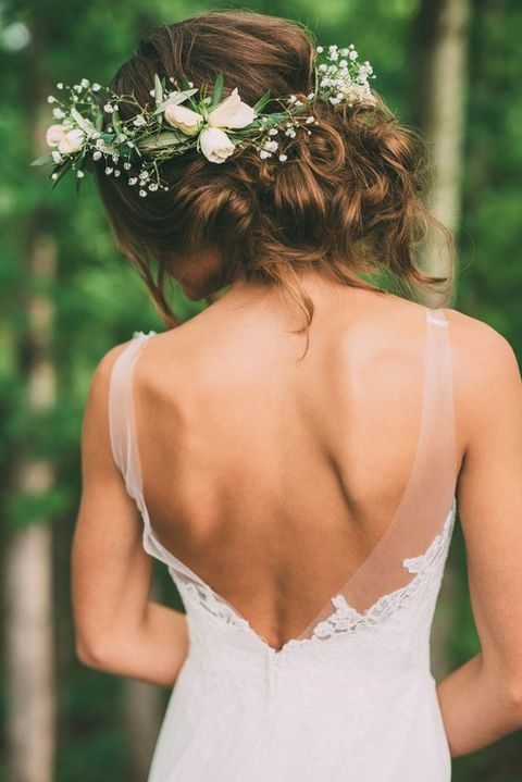 messy curly updo with baby's breath and white flowers