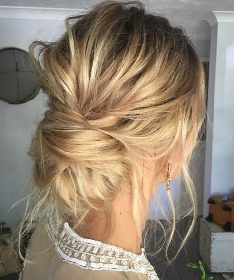 messy low bun with hair down