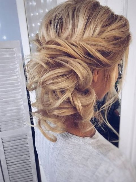 messy twisted updo with hair down