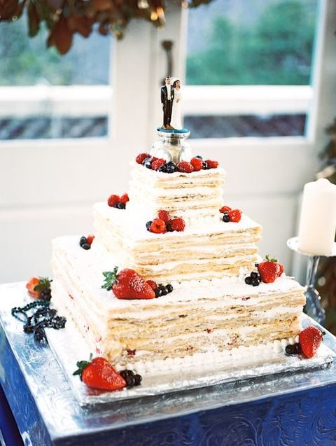 millefoglie wedding cake topped with fresh berries