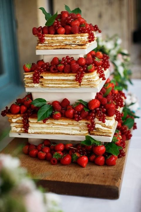 millefoglie wedding cake tower with fresh berries on top