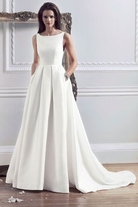 modern bateau neckline sleeveless wedding dress with a pleated skirt and pockets