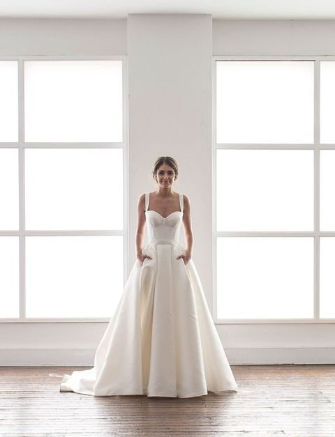 modern wedding dress in cream with a bustier and a full skirt with pockets by Karen Willis Holmes