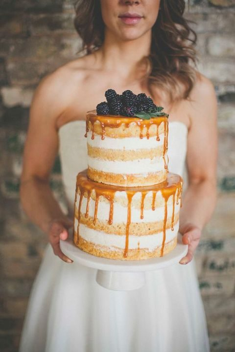 naked honey drip wedding cake topped with blackberries