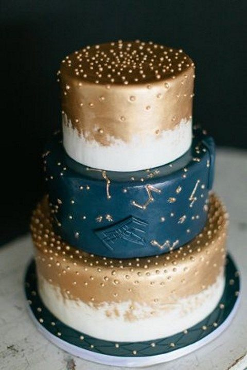 navy and copper wedding cake with constellations