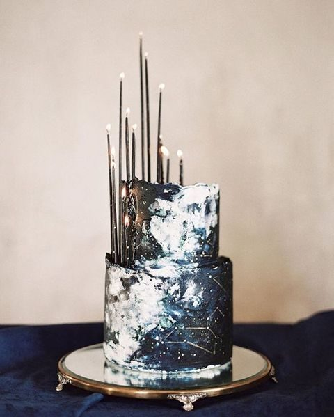navy and white constellation wedding cake with thin black candles