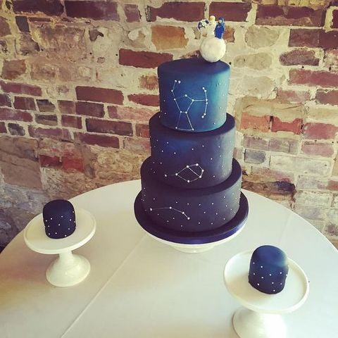 navy wedding cake with white constellations and some individual cakes