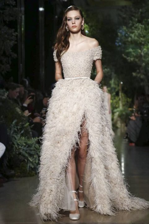 off the shoulder ostric feather wedding dress witih a high front slit and a beaded bodice