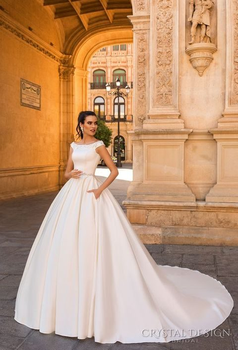 off the shoulder plain ballgown with pockets and embellishments