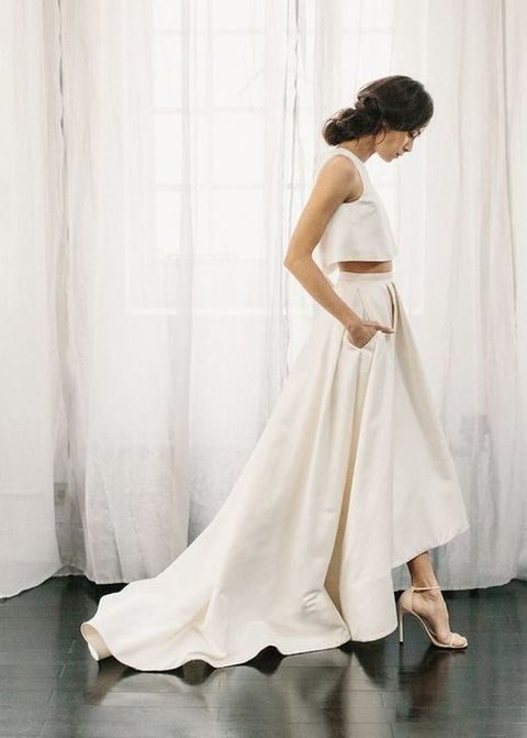 plain bridal separate with a halter neckline crop top and a high low train skirt with pockets