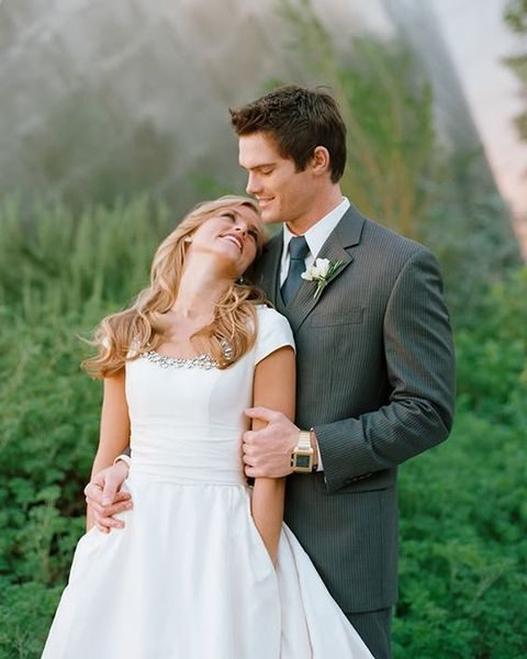 plain cap sleeve wedding dress with an embellished neckline and pockets