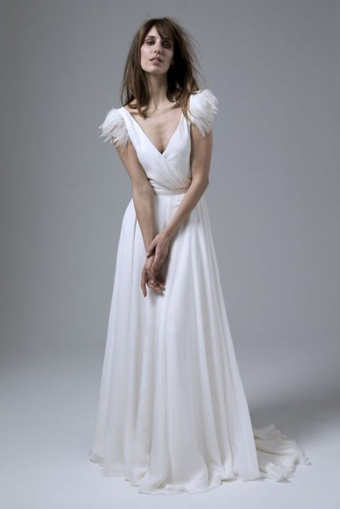 plain deep V-neckline wedding dress by Halfpenny London with feathered shoulders