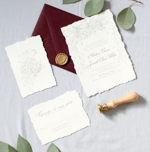 raw edge invites with calligraphy and a burgundy envelope