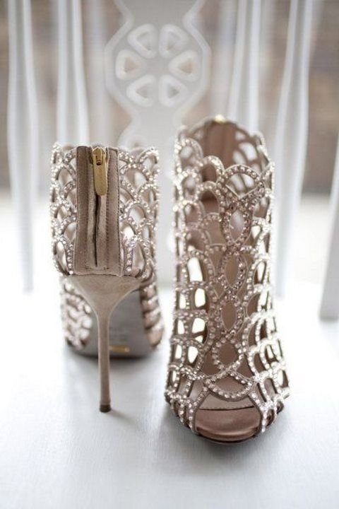 scallop laser cut high heeled booties with embellishments all over