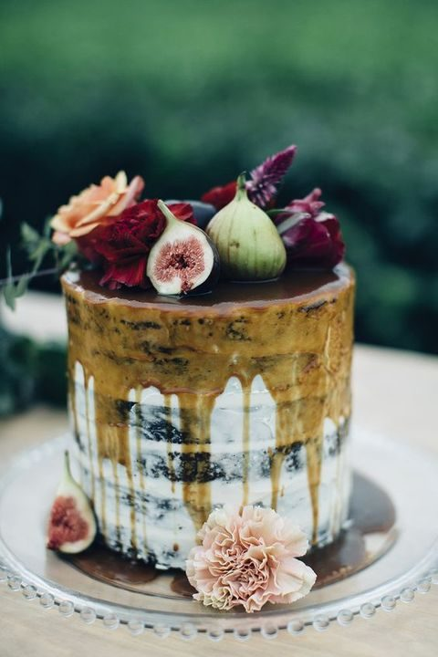 semi naked chocolate wedding cake with honey drip, topped with figs and flowers