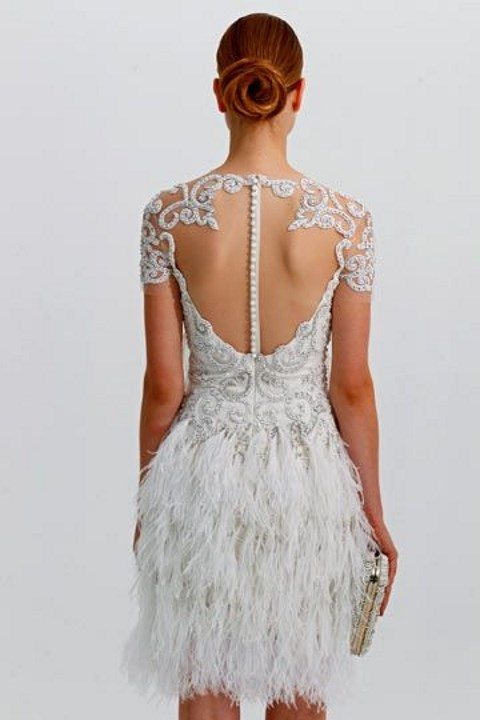 short embellished short sleeve wedding dress with an illusion back and a feather skirt