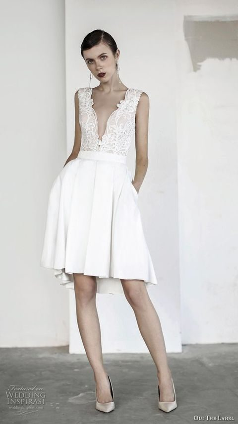 short sleeveless wedding dress with a plunging neckline, a pleated skirt with pockets