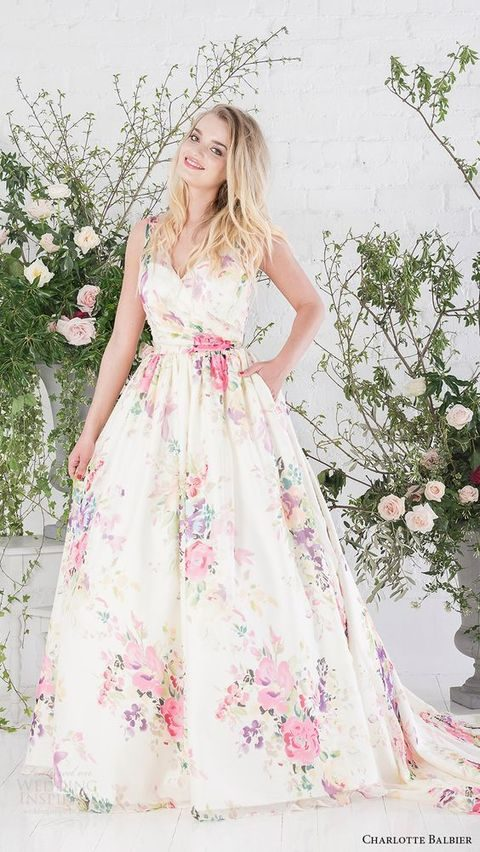 sleeveless V-neck wedding dress with a multicolor floral print, pockets and a train