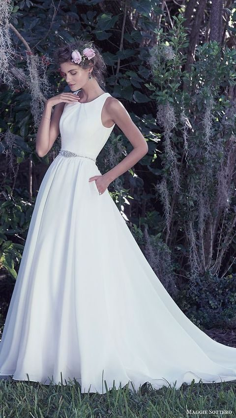sleeveless plain wedding dress with pockets and an embellished sash by Maggie Sottero