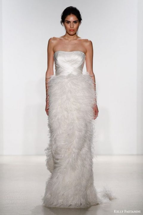 strapless draped bodice wedding dress with a feather skirt by Kelly Faetanini